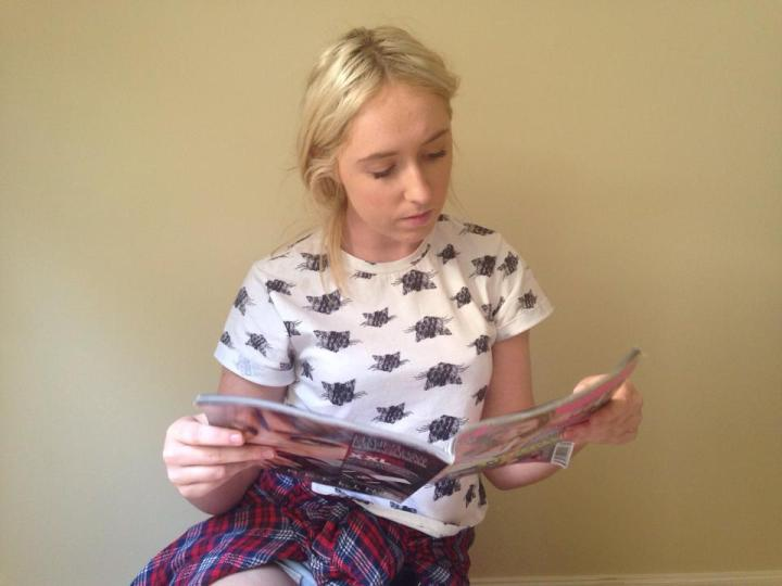 Kayla Chapman reads a women's magazine that she aspires to contribute to one day
